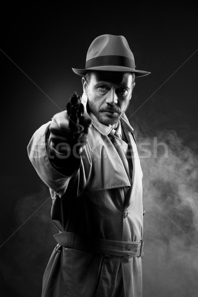 Vintage agent pointing a gun Stock photo © stokkete