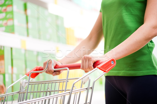 Supping cart and supermarket shelf Stock photo © stokkete