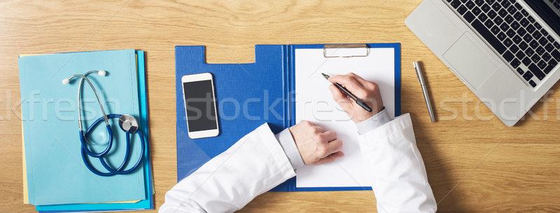 Médicos área de trabalho médico trabalhando mesa de escritório escrita Foto stock © stokkete