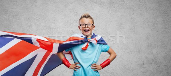 Smiling superhero posing Stock photo © stokkete