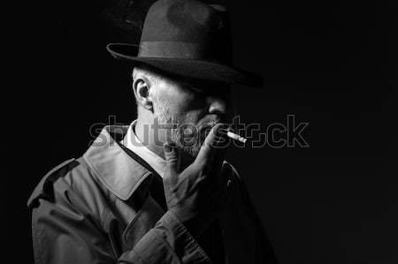 Film noir: detective in the dark with a gun Stock photo © stokkete