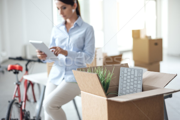Business woman moving in a new office Stock photo © stokkete