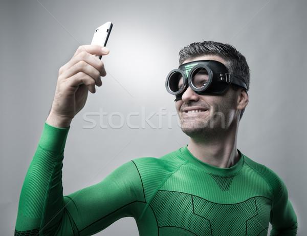 Superhero смартфон улыбаясь связи Сток-фото © stokkete