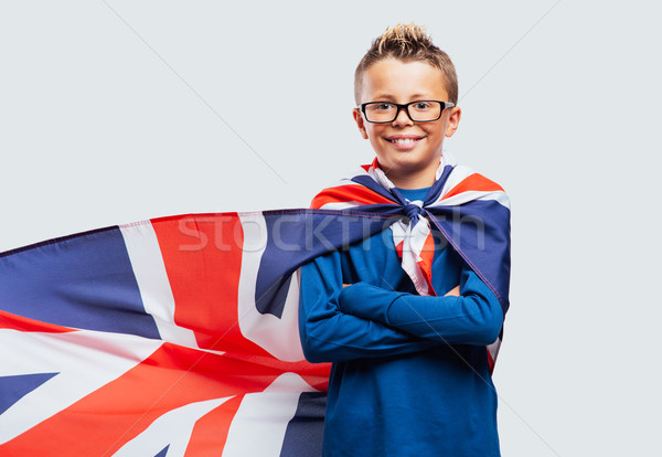 Smiling superhero boy with British flag cape Stock photo © stokkete