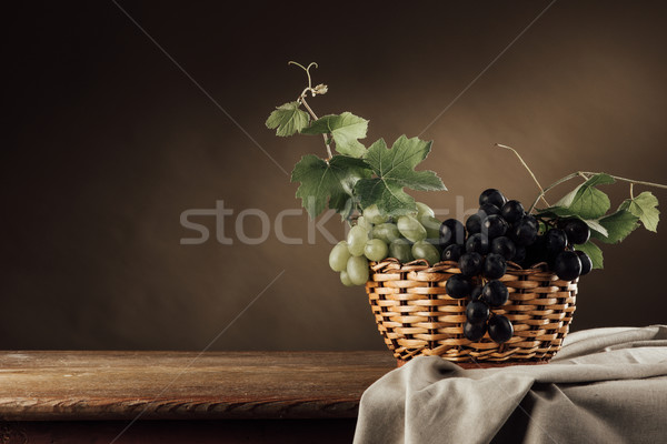 Grapes in a basket still life Stock photo © stokkete
