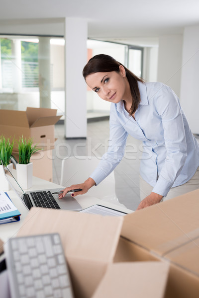 Confident businesswoman working in her new office Stock photo © stokkete