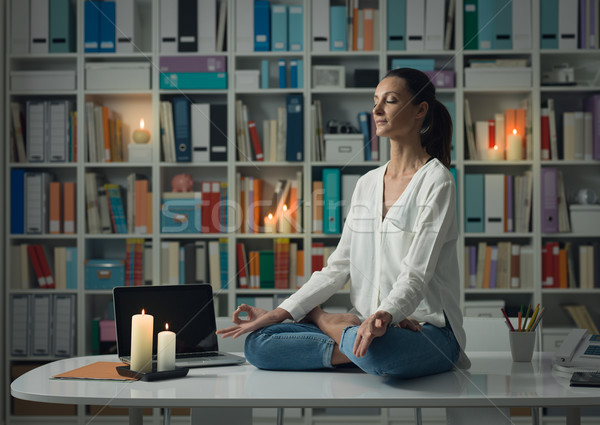 Woman practicing meditation at home Stock photo © stokkete