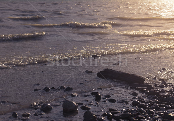 Lake and beach with stones Stock photo © stokkete