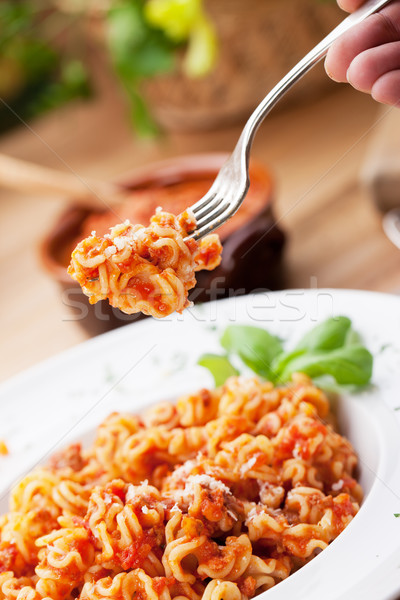 Tészta paradicsomszósz olasz étel parmezán sajt étel vacsora Stock fotó © stokkete