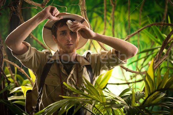 Exhausted young explorer in the jungle Stock photo © stokkete