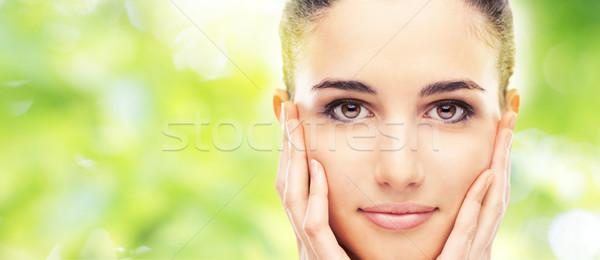 Beautiful young model touching her skin Stock photo © stokkete