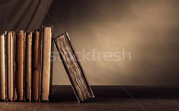 Ancient books on a shelf Stock photo © stokkete