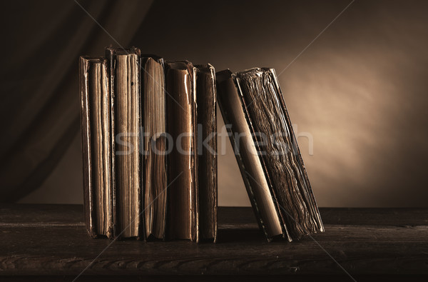 Ancient books on an old table Stock photo © stokkete