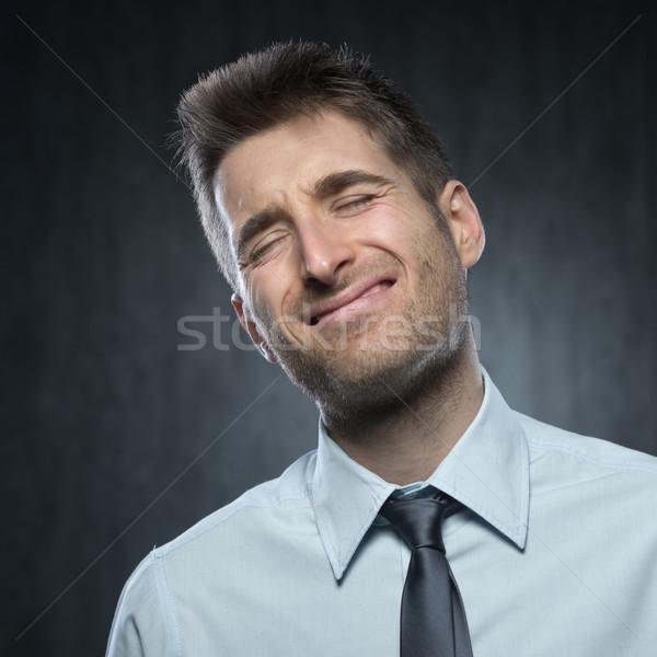 Uczucie ból młody człowiek bolesny człowiek biznesmen Zdjęcia stock © stokkete