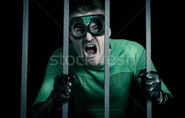 Superhero locked in prison Stock photo © stokkete
