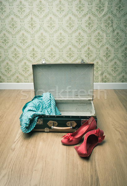 Glamour woman packing Stock photo © stokkete