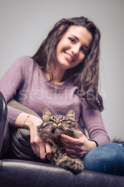 Young woman cuddling a cat Stock photo © stokkete