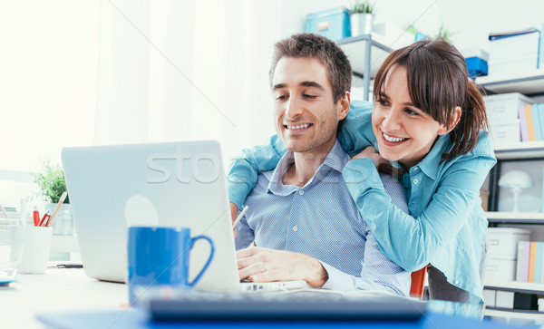 Young couple surfing the web at home Stock photo © stokkete