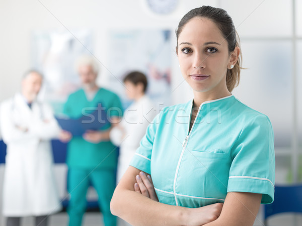 Medical team posing at the hospital Stock photo © stokkete