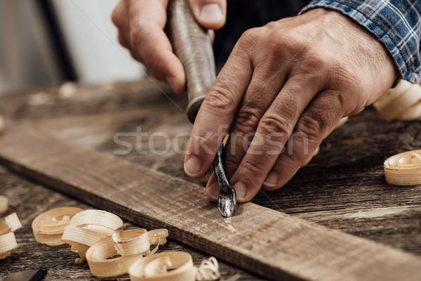 Carpenter carving wood Stock photo © stokkete
