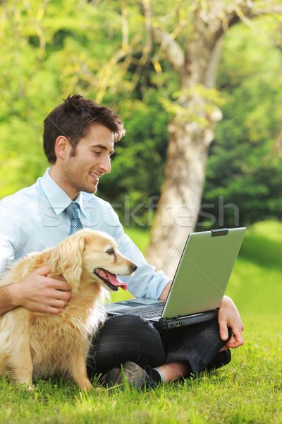 Melhor amigo jovem homem de negócios cão trabalhando ao ar livre Foto stock © stokkete