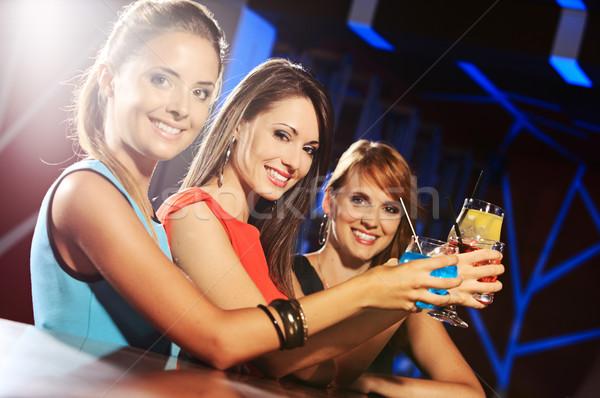 Cocktail party groep gelukkig mooie jonge vrouwelijke Stockfoto © stokkete