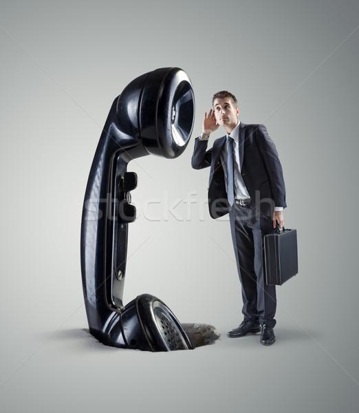 Affaires téléphone jeunes énorme rétro costume Photo stock © stokkete