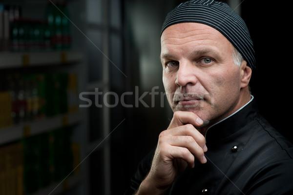 Chef retrato mão queixo escuro cozinha Foto stock © stokkete