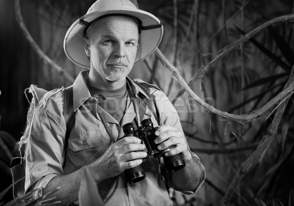 Aventureiro selva binóculo sorridente explorador colonial Foto stock © stokkete