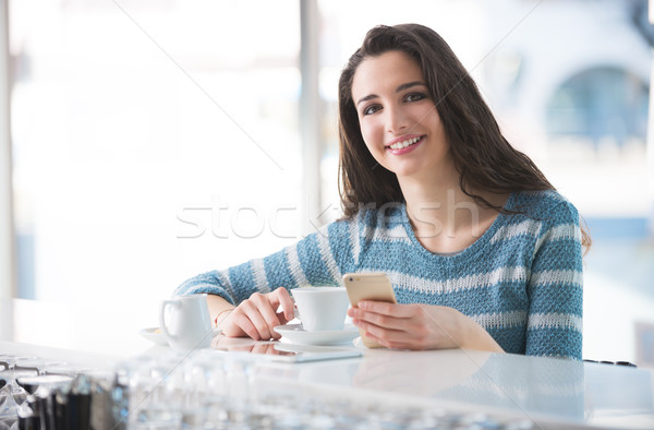 Stock photo: Beautiful girl leaning at the bar counter
