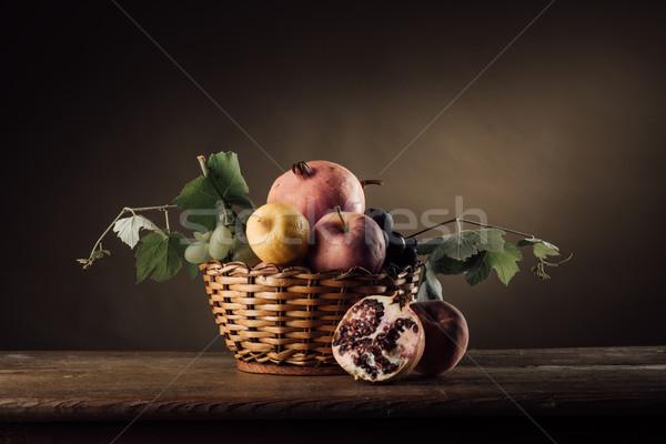 Fruit in a basket still life Stock photo © stokkete