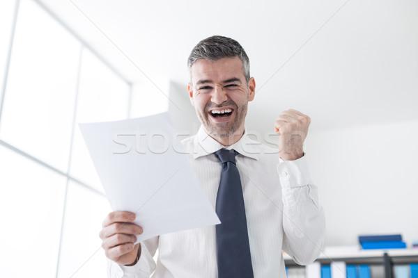 Cheerful businessman receiving good news Stock photo © stokkete
