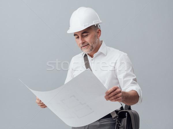 Architect checking a blueprint Stock photo © stokkete