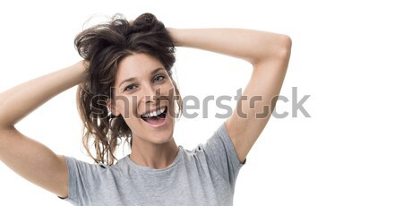 Cheerful woman with messy hair Stock photo © stokkete