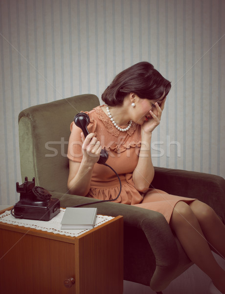 Crying woman receives a bad news Stock photo © stokkete