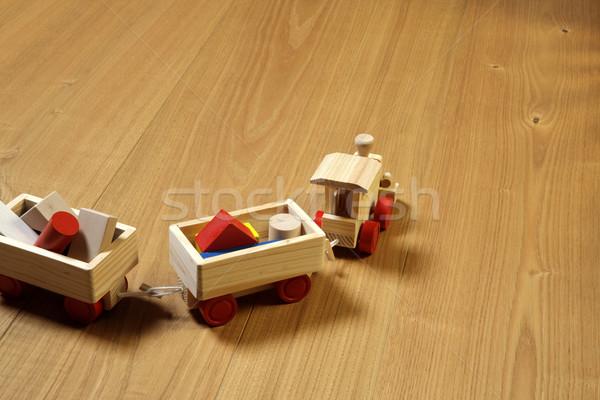 woodden train toy on parquet.  Stock photo © stokkete