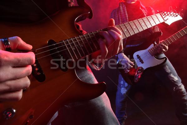 Live rock muzikanten spelen concert muziek Stockfoto © stokkete
