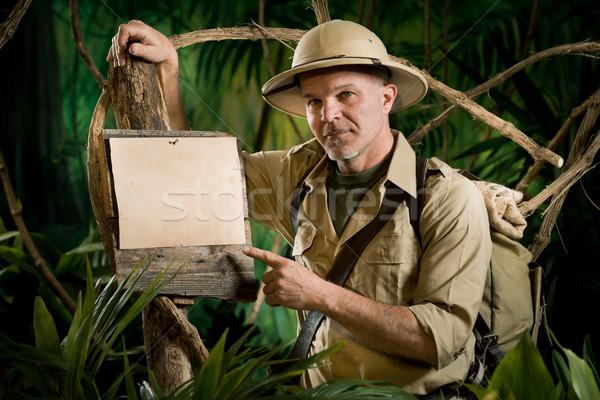 Explorador indicação assinar olhando câmera diversão Foto stock © stokkete