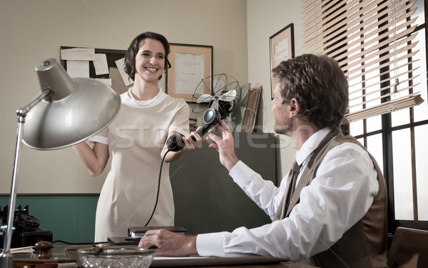 Young vintage secretary holding phone receiver Stock photo © stokkete