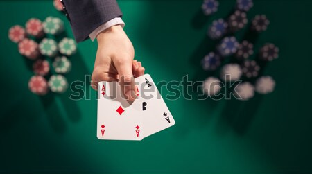 Poker player holding two aces Stock photo © stokkete