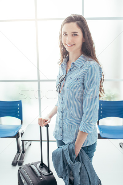 Young woman in terminal waiting room Stock photo © stokkete