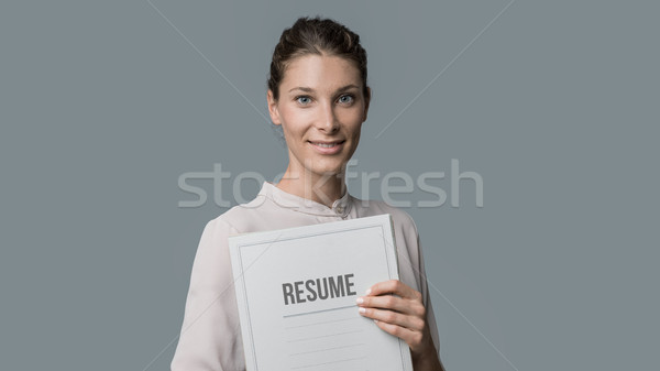 woman holding her resume Stock photo © stokkete