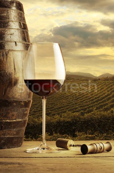 Vino tinto vidrio copa de vino vina vino puesta de sol Foto stock © stokkete
