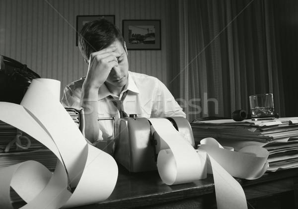 Kimerült üzletember fáradt ül asztal tele Stock fotó © stokkete