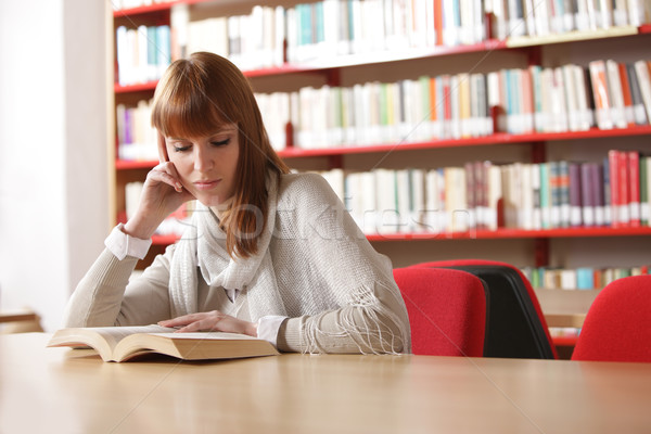 Stock photo: Young student in a library