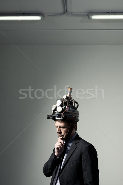 Creative businessman with steampunk helmet Stock photo © stokkete