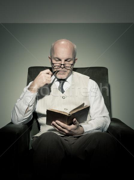 Professor reading in armchair Stock photo © stokkete