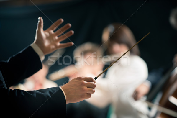 Orchestra conductor on stage Stock photo © stokkete
