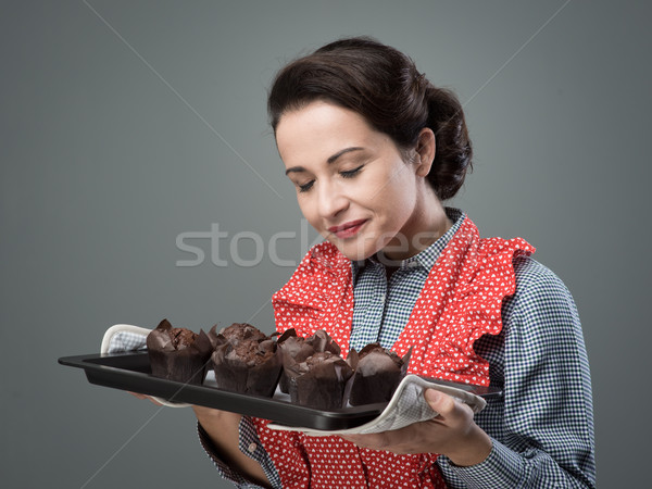 Vintage housewife with home made muffins Stock photo © stokkete