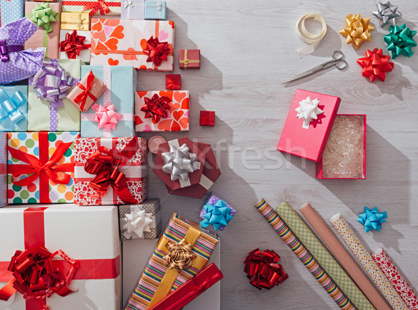 Wrapping Christmas gifts Stock photo © stokkete